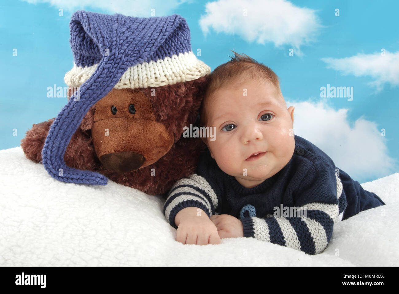 turning difficulty, disabled child, chubby little boy, large infant - Stock Image