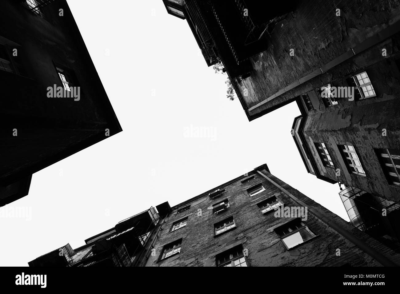 Black and white photo of a building captured from below. - Stock Image