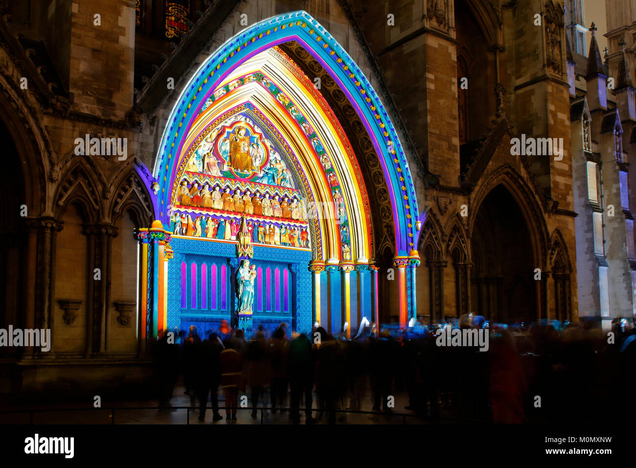 London Lumiere 2018 a festival of illuminated art installations shown here on Westminster Abbey are colourful projected - Stock Image
