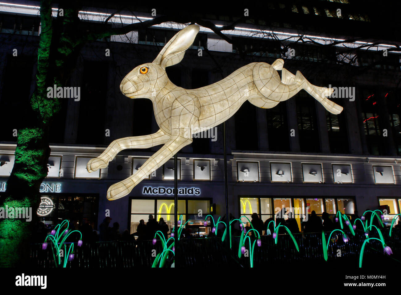 London Lumiere 2018 a festival of illuminated art installations leaping Hare artwork in Leicester Square - Stock Image