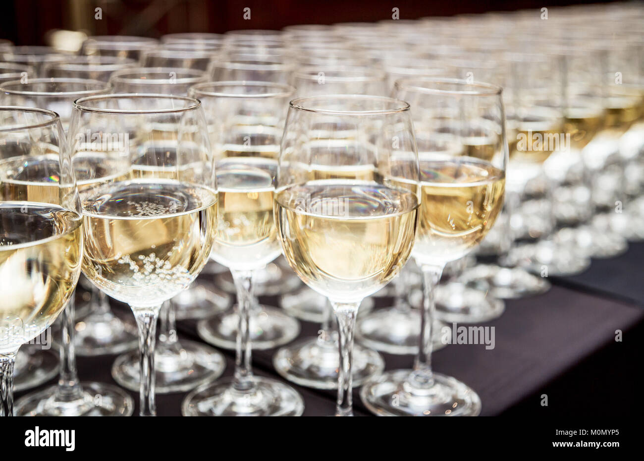 Glasses of sparkling wine. Cocktail party. - Stock Image
