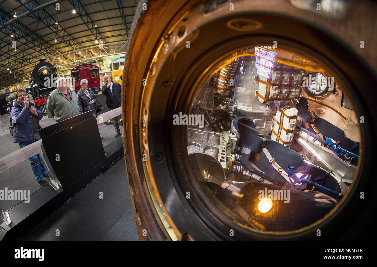 Vistors view the Soyuz TMA-19M used by astronaut Tim Peake, that has gone on display at the National Railway Museum - Stock Image