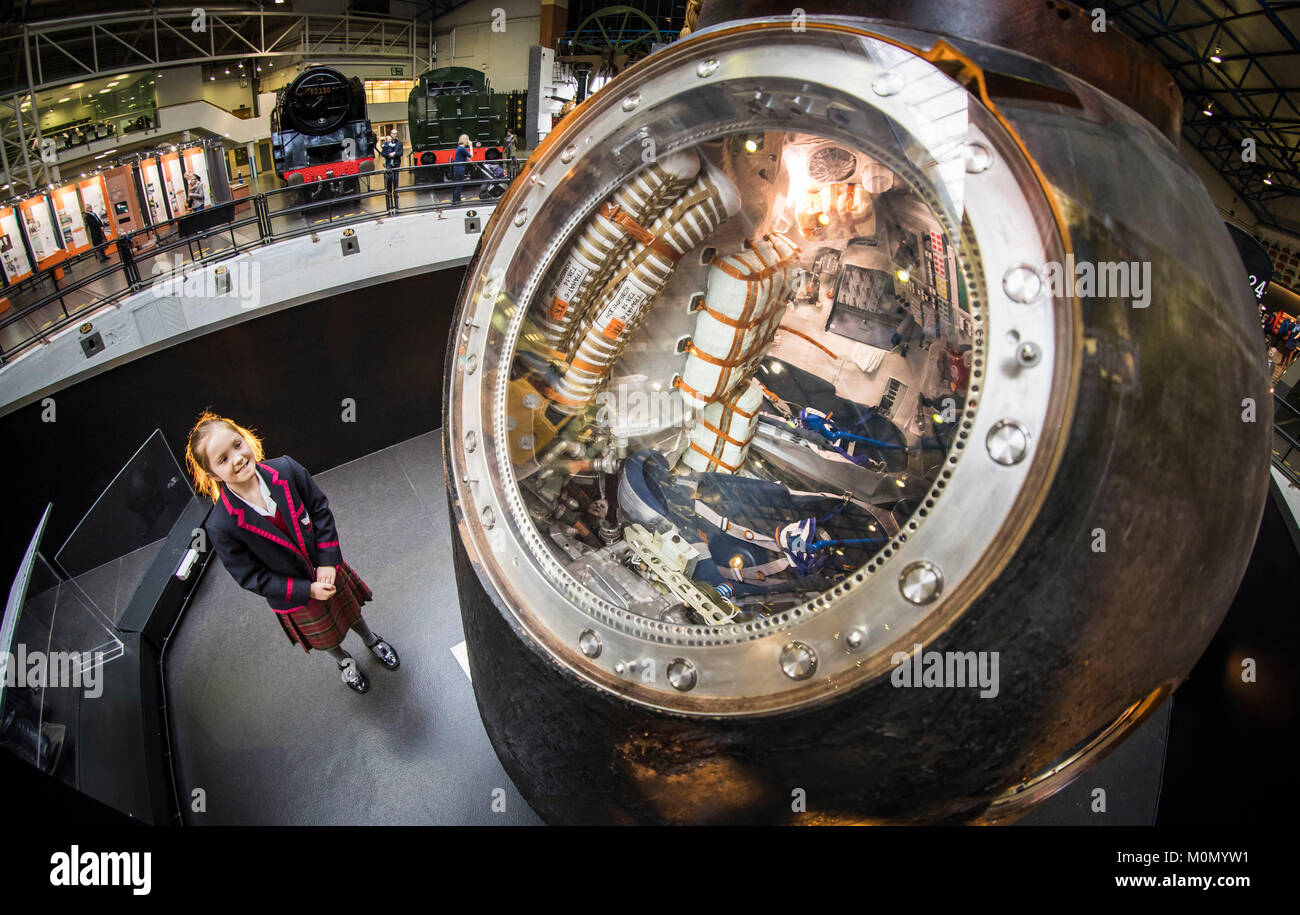 Poppy Faulkner, 9, from Yarm Preparatory School with the Soyuz TMA-19M used by astronaut Tim Peake, that has gone - Stock Image