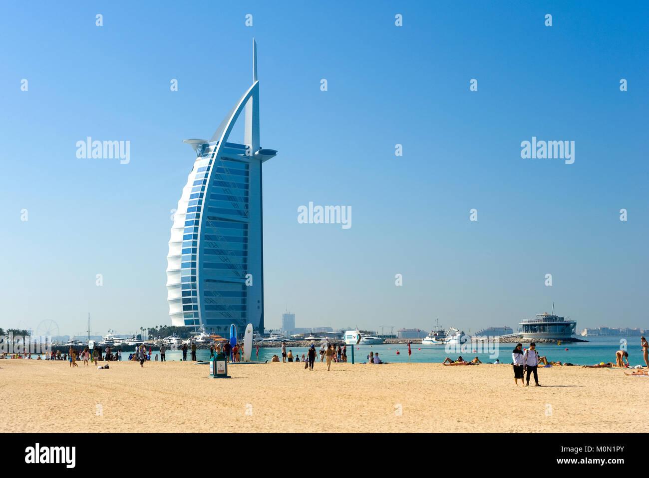 DUBAI, UNITED ARAB EMIRATES - JAN 02, 2018: Public beach of Dubai near the Burj Al Arab hotel. - Stock Image