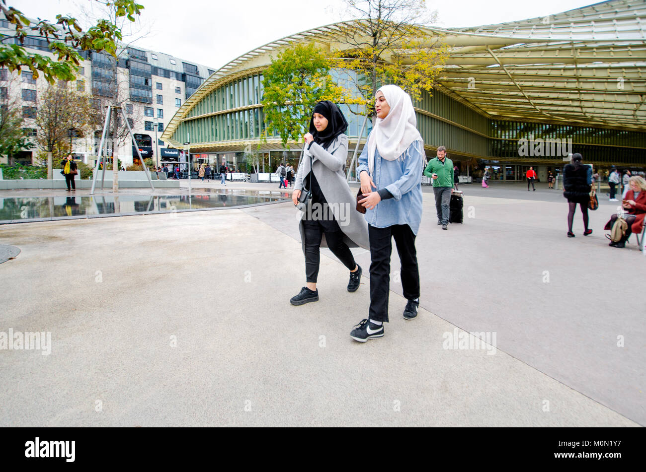 Paris, France. To young Muslim women with headscarves / Hijabs in Forum des Halles - Stock Image