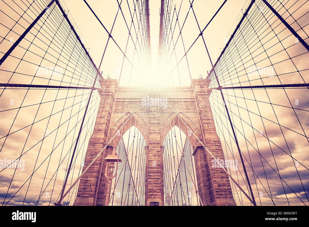 Wide angle picture of the Brooklyn Bridge at sunset, color toned picture, USA. - Stock Image
