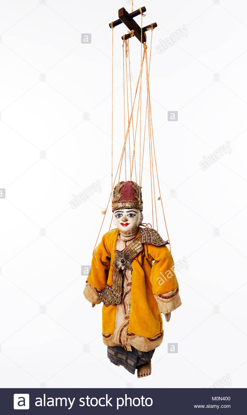 Suspended by wires ancient Asian wooden marionette representing a ...