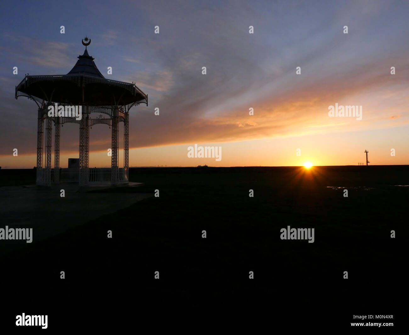 Sunset behind bandstand, West Battery Gardens, Southsea, Portsmouth, England, UK - Stock Image