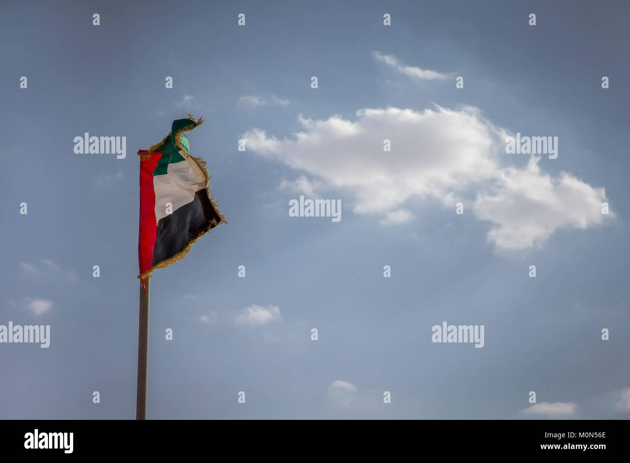 UAE flag flying in the wind Stock Photo