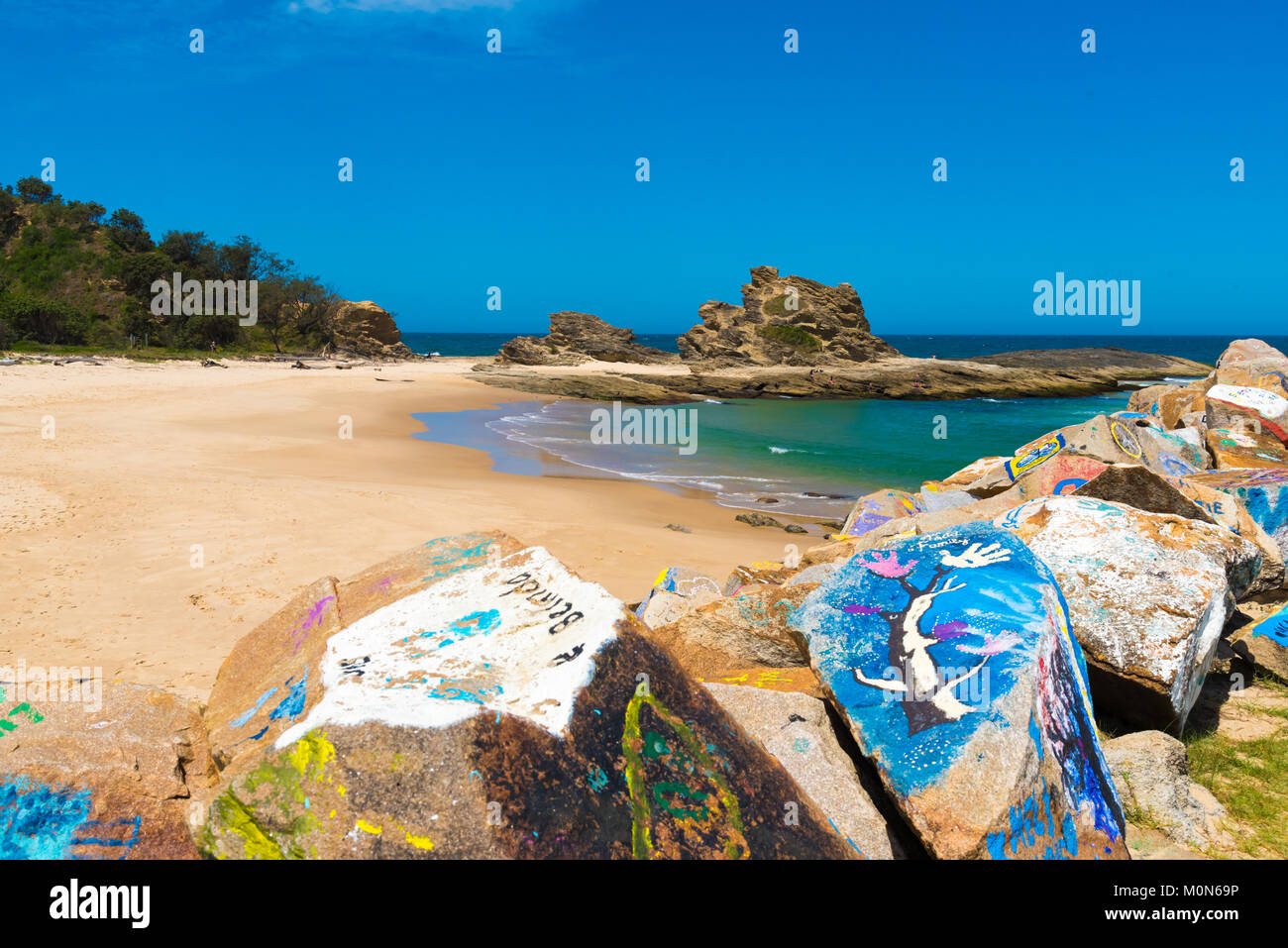 Nambucca Heads, NSW, Australia- December 19, 2017 : The Vee Wall, a breakwall of painted boulders is one of the - Stock Image