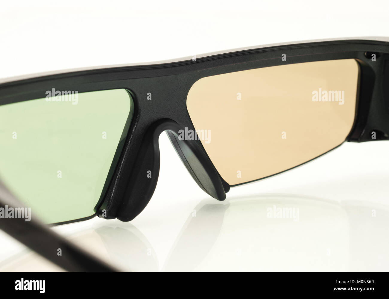 Stereo 3D TV: close up of active shutter glasses on white - Stock Image