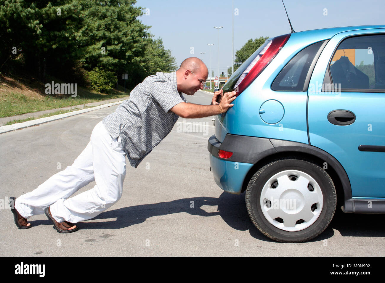 pushing cars stock photo 172571730 alamy