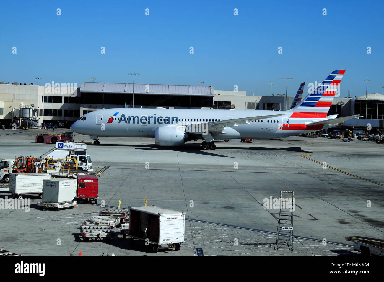 American Airlines plane standing on the tarmac being serviced prior to takeoff at LAX airport Los Angeles, California - Stock Image