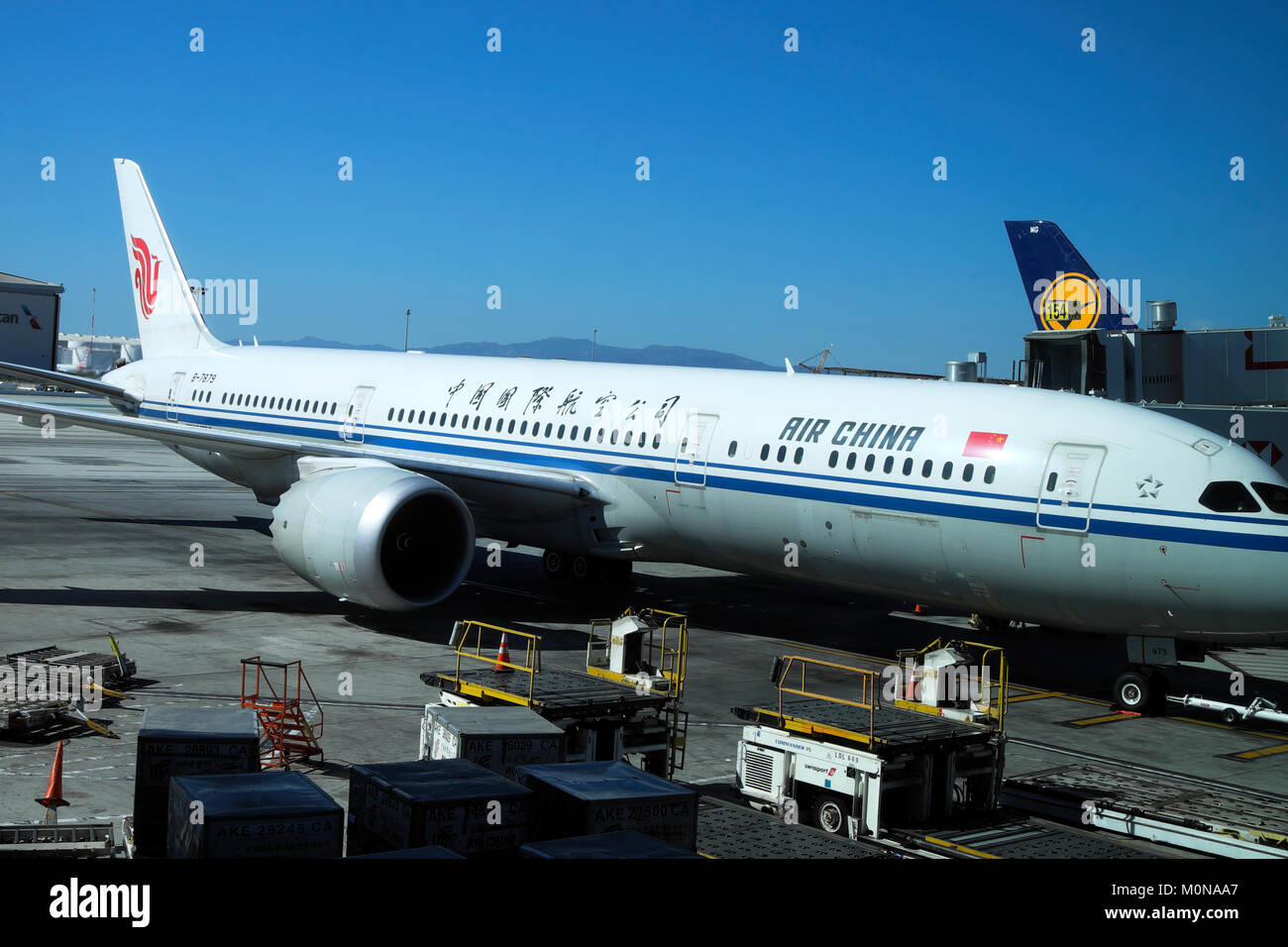 Air China Airlines plane standing on the tarmac being serviced prior to takeoff at LAX airport Los Angeles, California - Stock Image