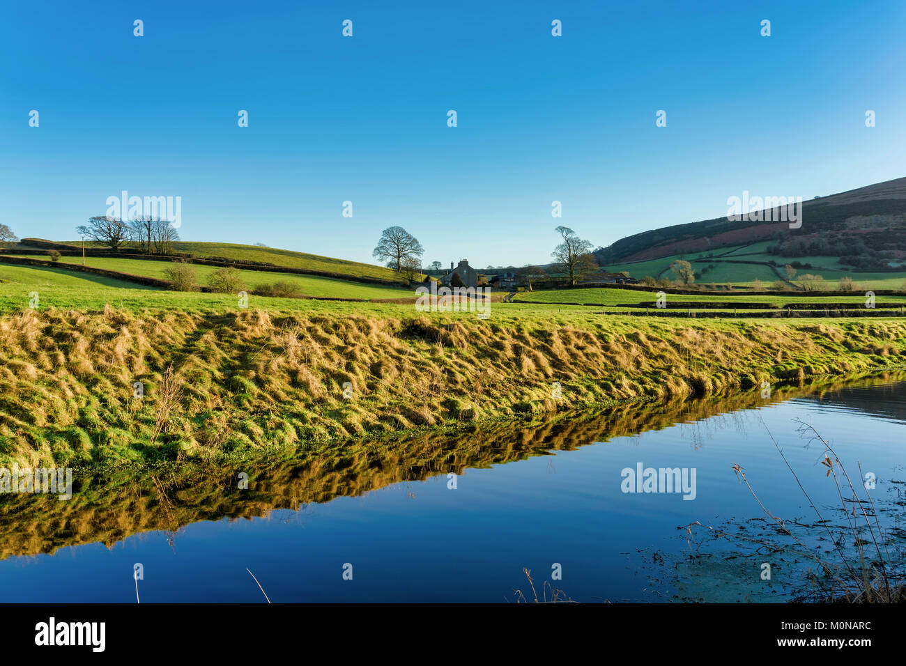 An oblique view of the Lancaster canal with Farleton Fell in the distance - Stock Image