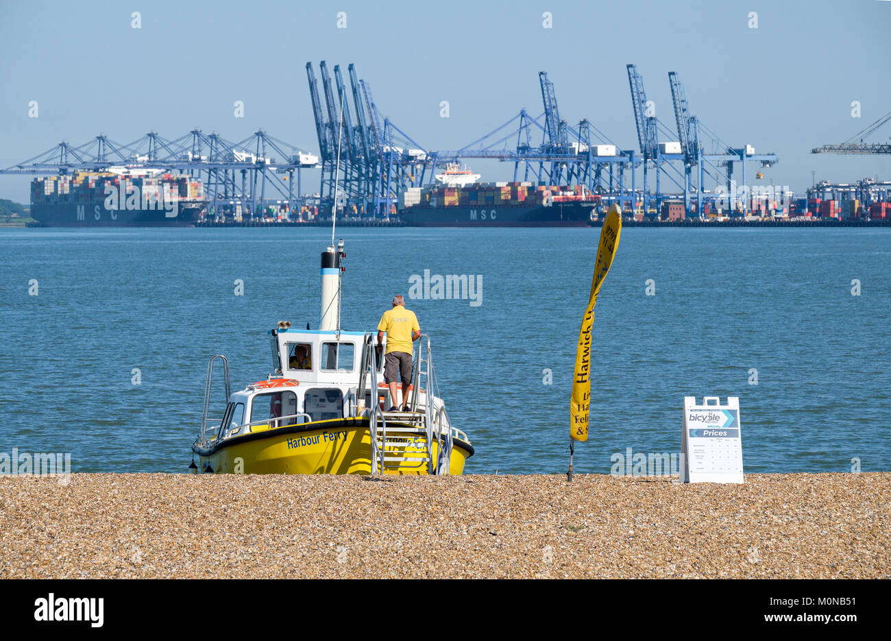 Man boarding the Harwich harbour foot/bicycle ferry ready to depart from Landguard point, Felixstowe, Suffolk, England, - Stock Image