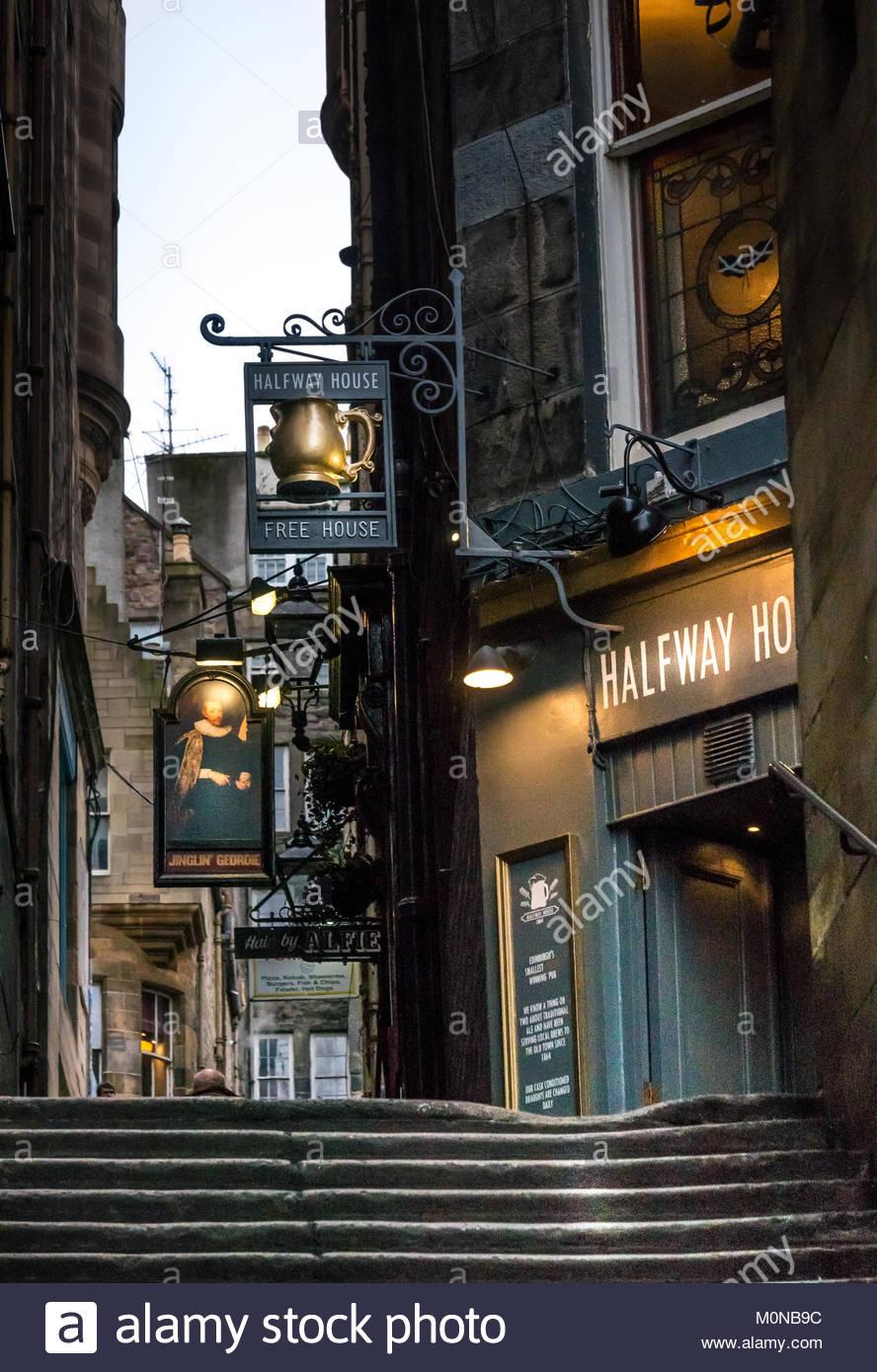 Pub signs for Jinglin Geordie and Halfway House pubs in dark alley, Fleshmarket Close, Edinburgh, Scotland, UK - Stock Image