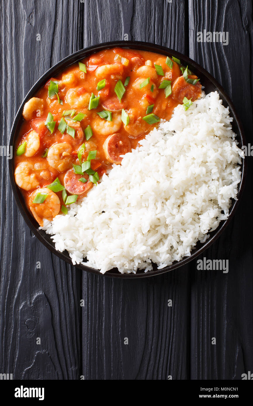 Delicious gumbo with prawns, sausage and rice macro on a plate on the table. Vertical top view from above - Stock Image