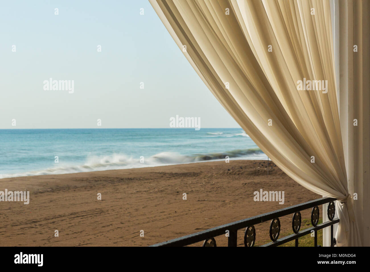 Abstract of a tulle curtain in the garden near a sandy beach as a nice background, long exposure during shut Stock Photo