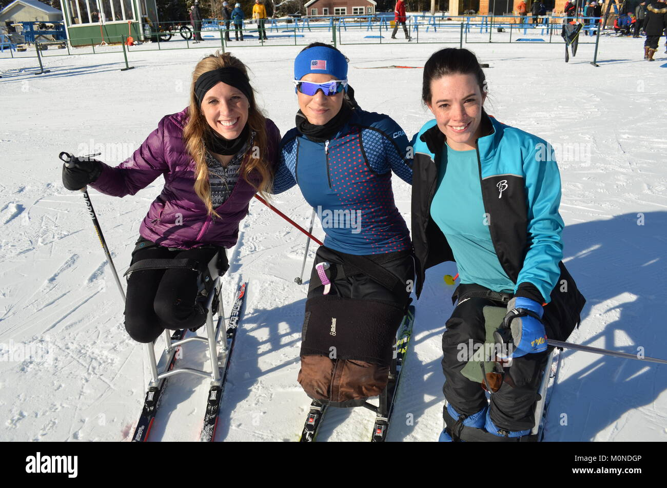 U.S. para skiers (left to right) Brittany Fisher, Oksana Masters, and Joy Rondeau at 2016 U.S. Paralympics Sit Ski - Stock Image