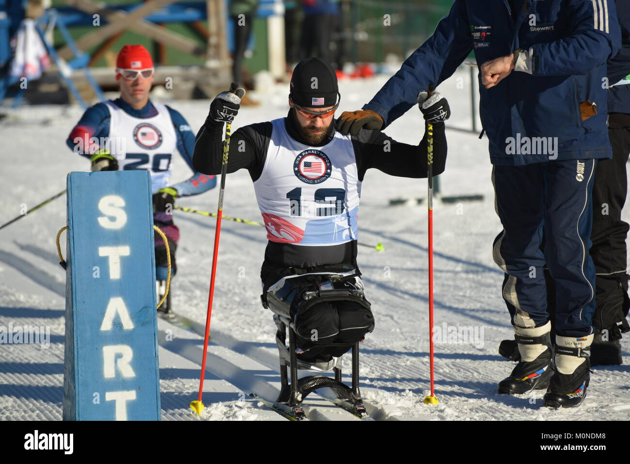 Paralympic cross country ski racer Aaron Pike starting race at 2016 U.S. Paralympics Sit Ski races, Craftsbury Outdoor - Stock Image
