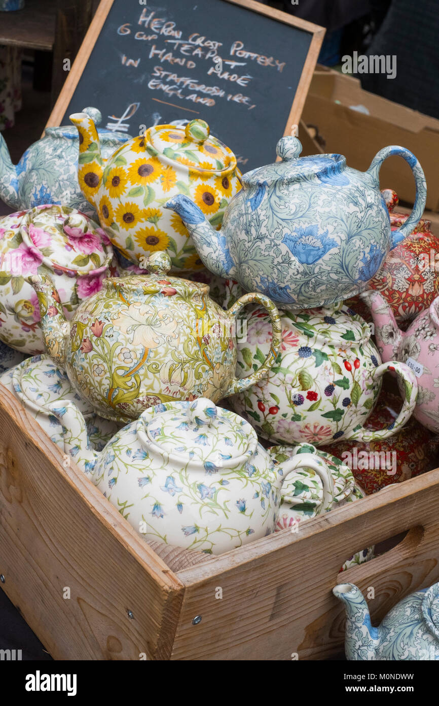 Selection of china teapots for sale at Ludlow market, Shropshire, England, UK - Stock Image