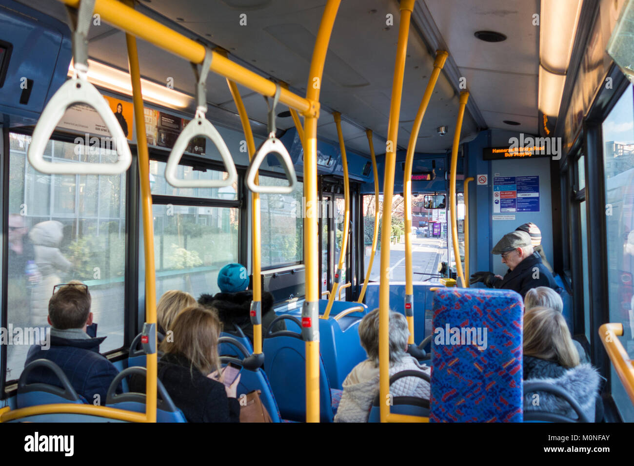 TFL 209 Bus interior and bus is about to move announcements - Stock Image