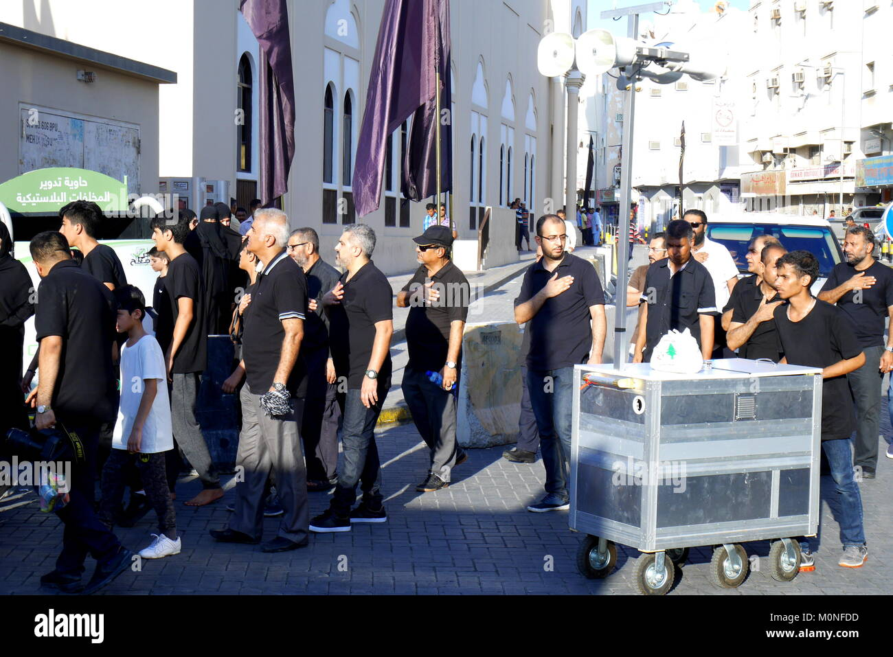 Shia Moslems march in Manama, Bahrain, at Ashura, to commemorate the death of Prophet Mohammed's grandson Hussein - Stock Image