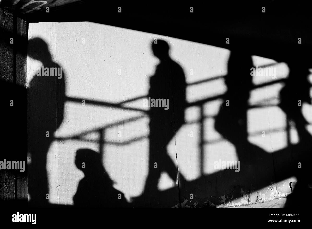 London Black and white street photography: Shadows of people descending stairs. - Stock Image