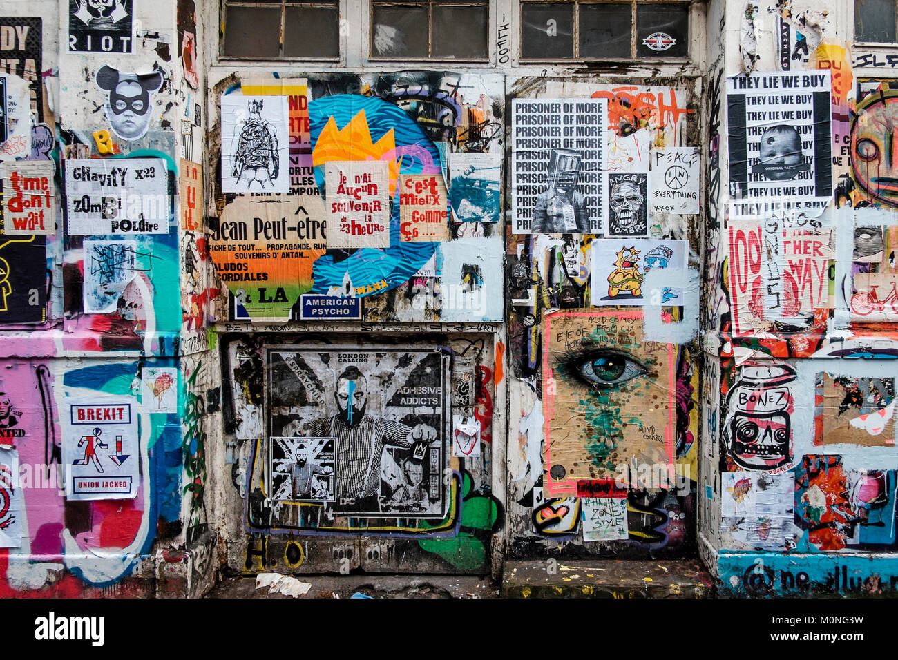 London urban photography: Street wall, covered with fly posters, Brick Lane, East London. - Stock Image