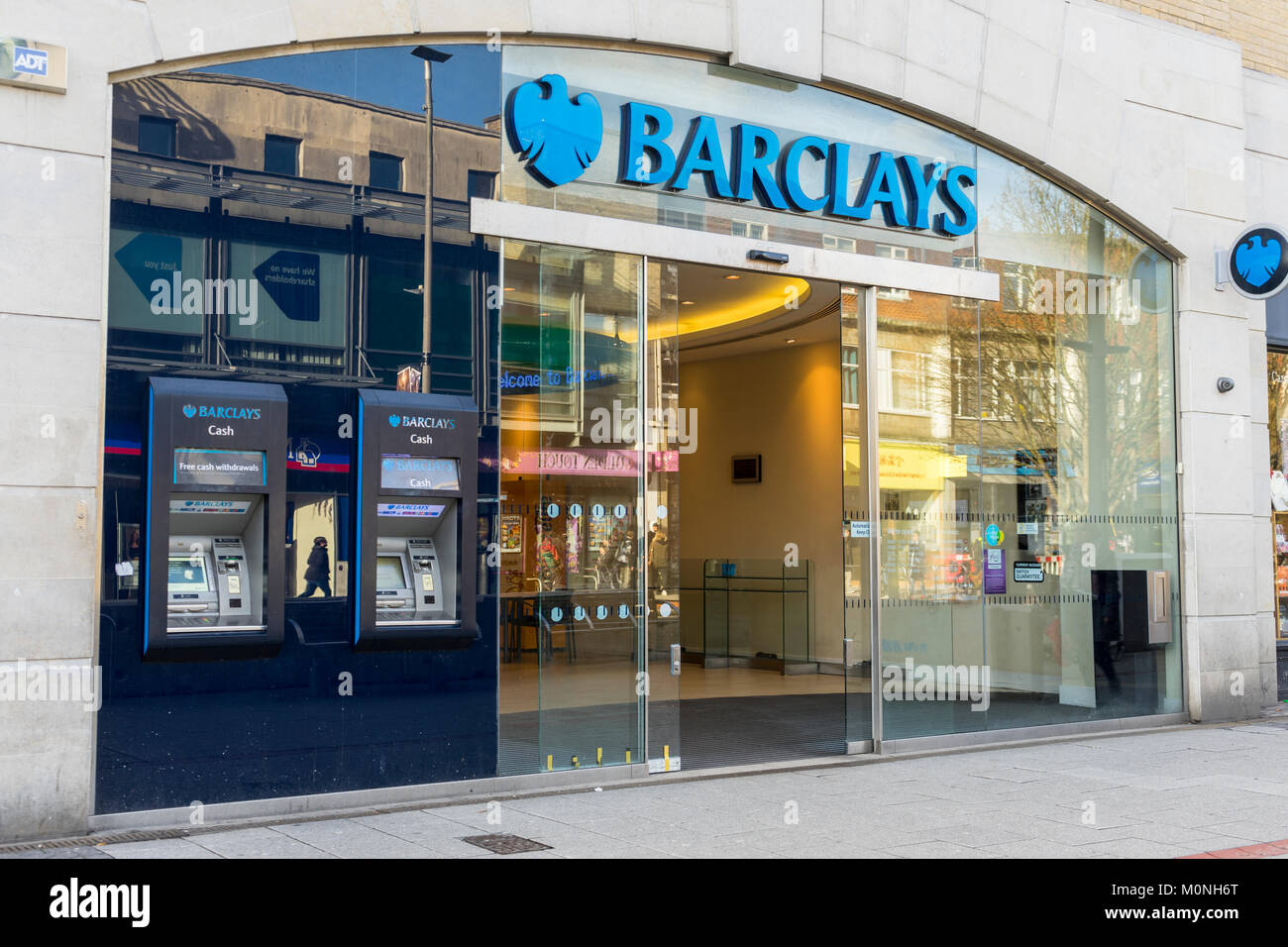 Entrance of a Barclays bank branch located along a High Street in England 2018, UK - Stock Image