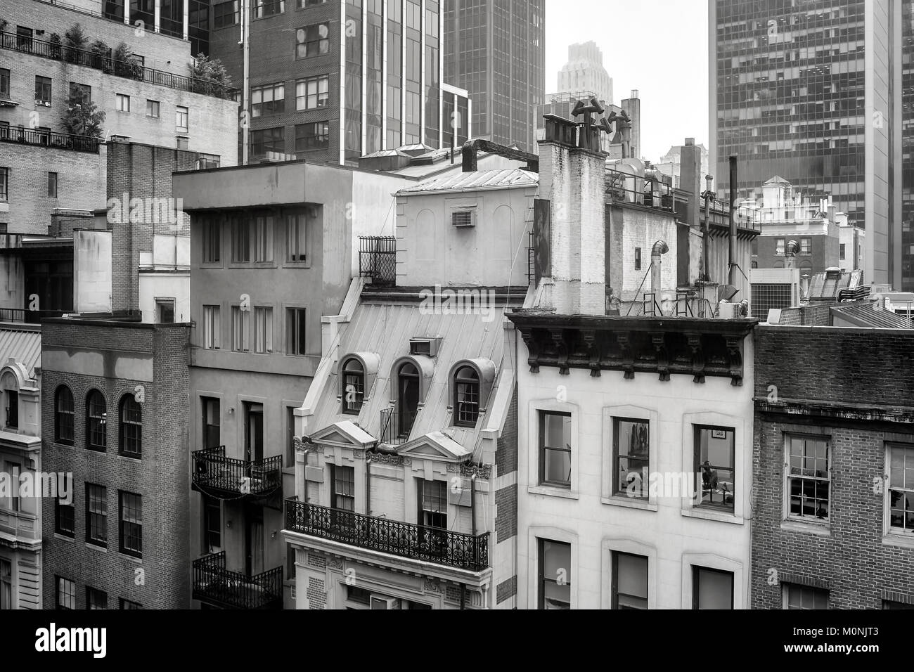 Black and white picture of old buildings in Midtown Manhattan on a rainy day, New York, USA. Stock Photo