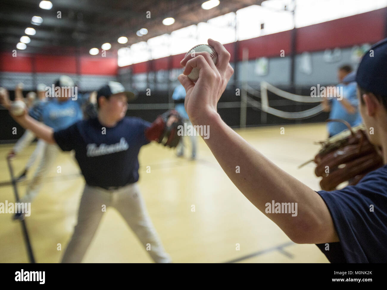 Pitchers training at an indoor training facility in New Jersey - Stock Image