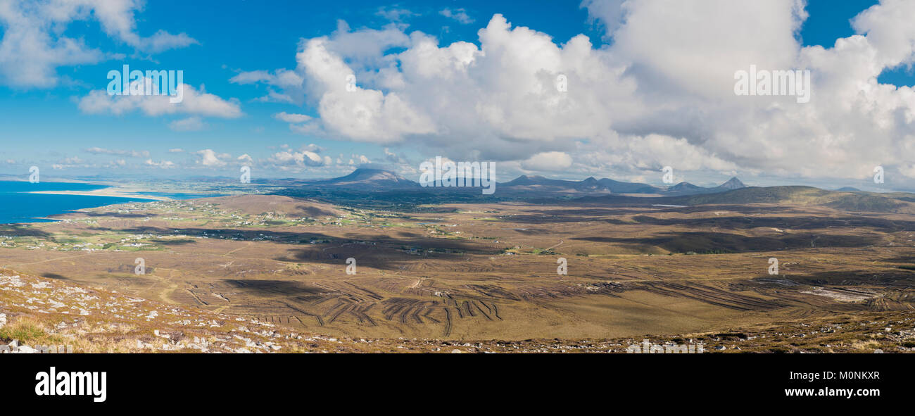 Panorama from high on Cnoc Fola across the cut bogland towards the  Seven Sisters of the Derryveagh Mountains, County - Stock Image