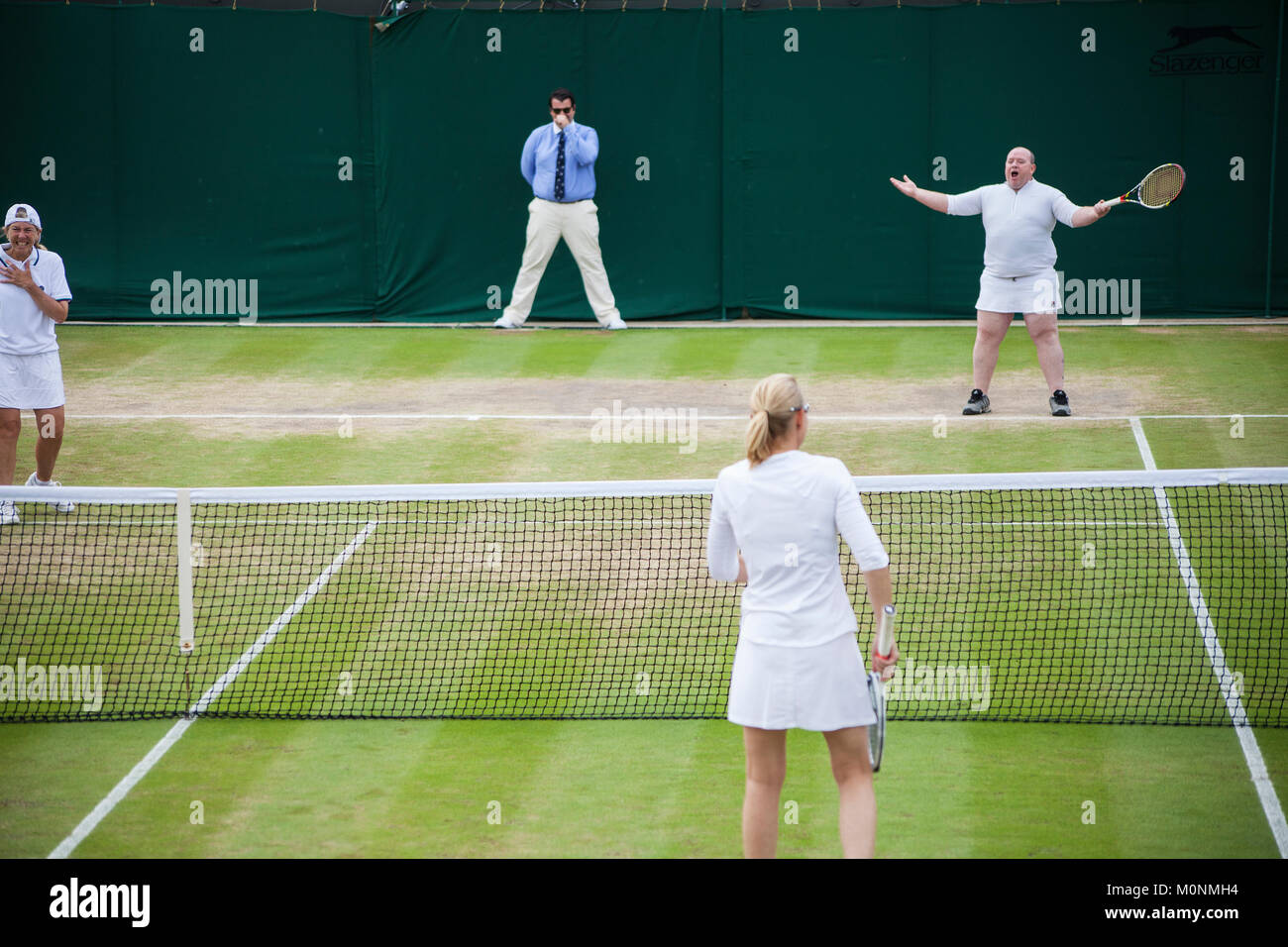 Kim Clijsters had a male fan put on a skirt and play a point at Wimbledon 2017  Ladies' Invitational Doubles - Stock Image