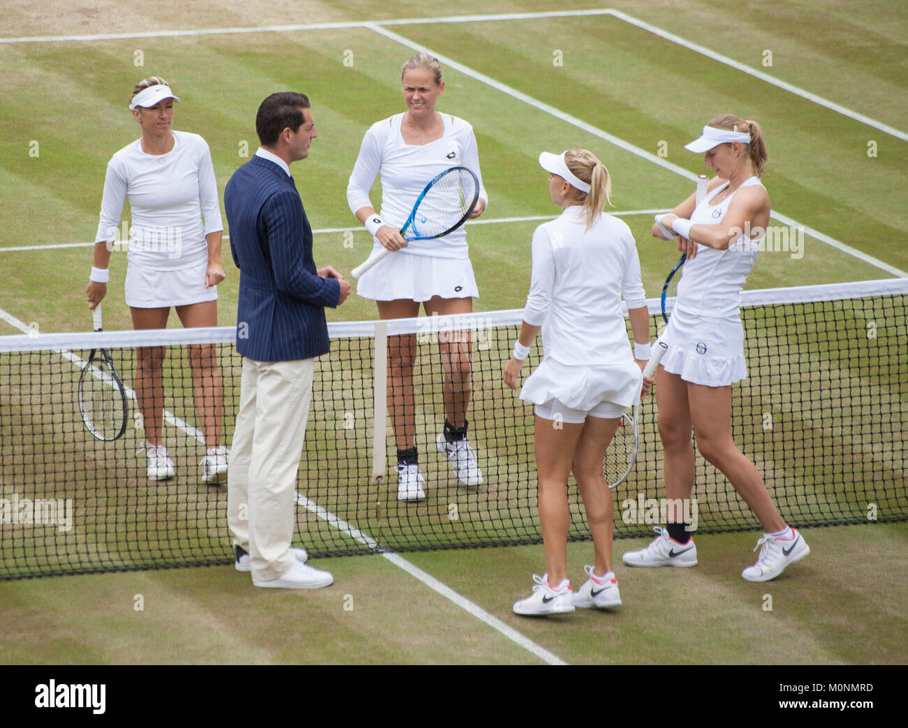 Umpire tosses coin, at start of womens doubles match,Centre Court Wimbledon tennis championship 2017, London, England, - Stock Image