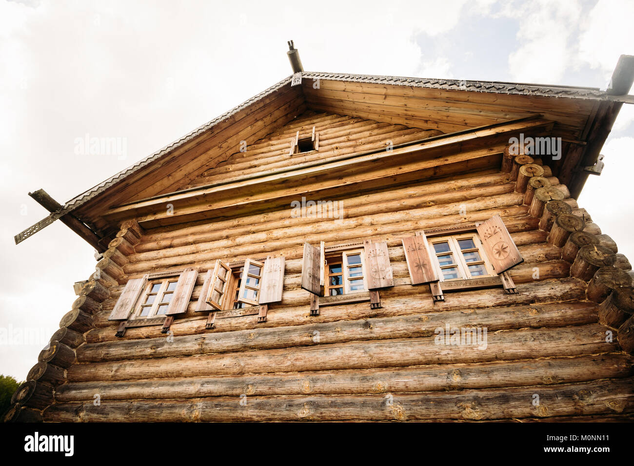 Wooden hut Slavic type against a gray sky. Stock Photo