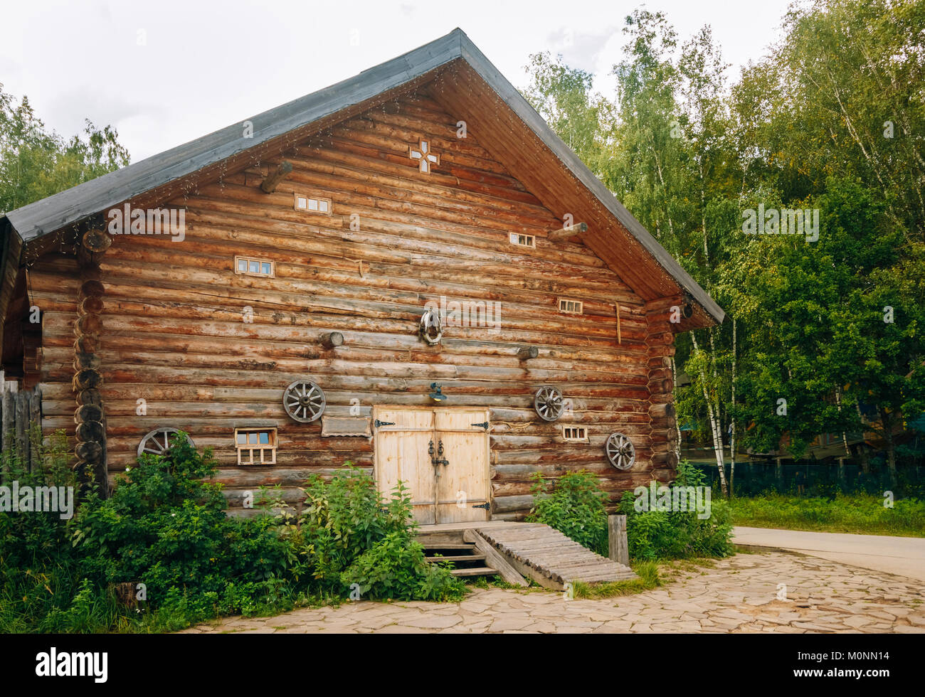 Wooden barn from a frame near the forest - Stock Image