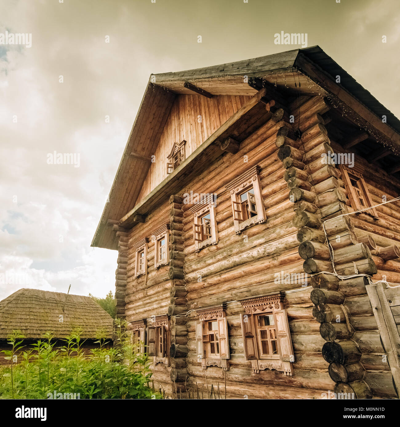 Wooden two-story log house Slavic type - Stock Image