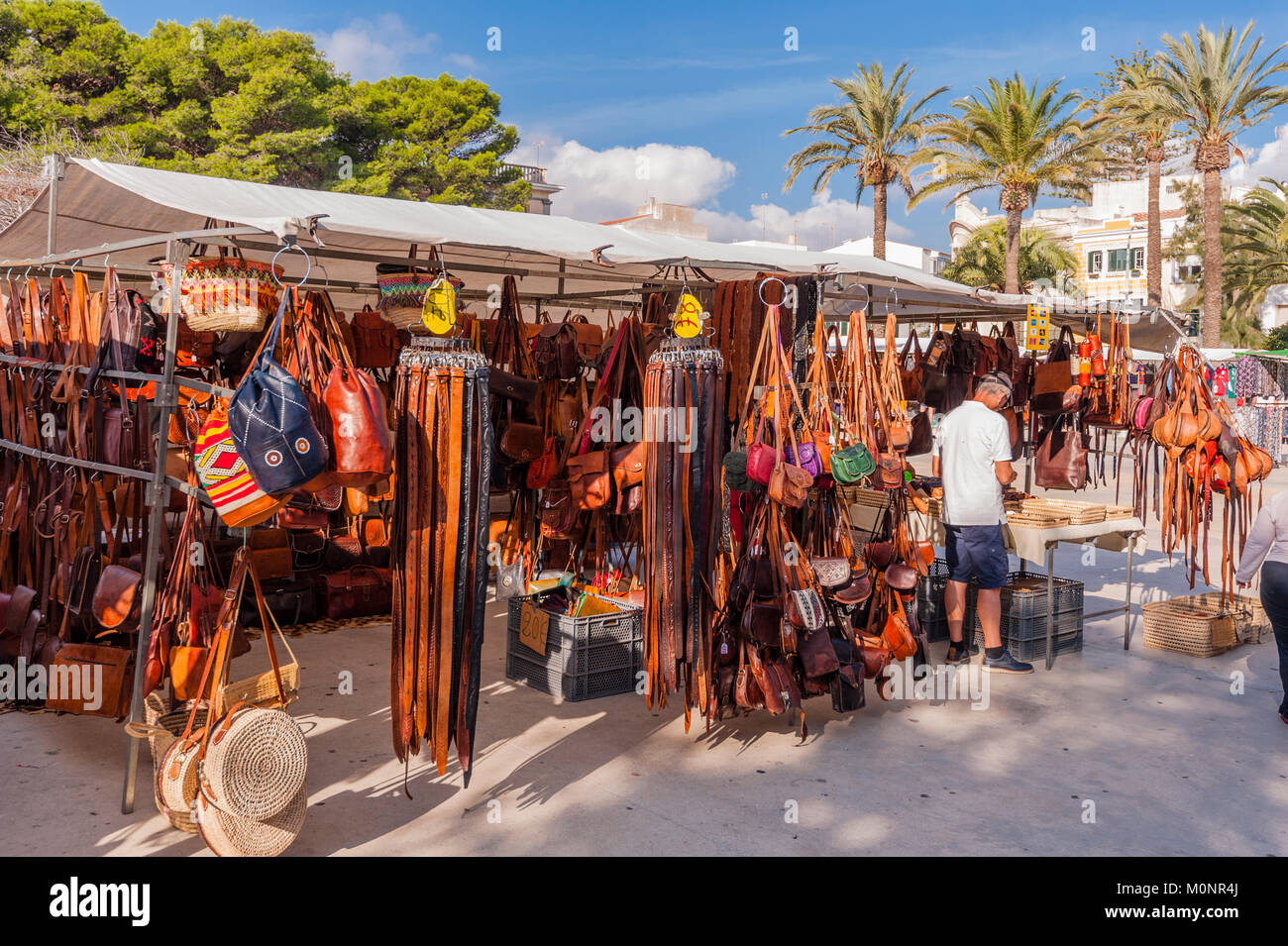 Leather belts and bags for sale at the street market in Mahon , Menorca , Balearic Islands , Spain - Stock Image