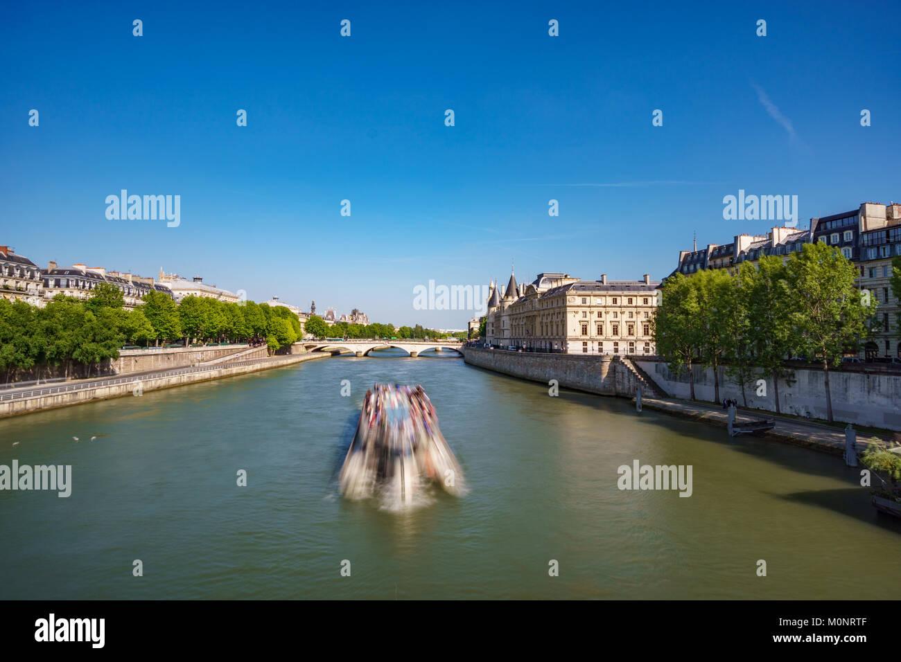 Blurred tourist boat over Seine river in Paris - Stock Image