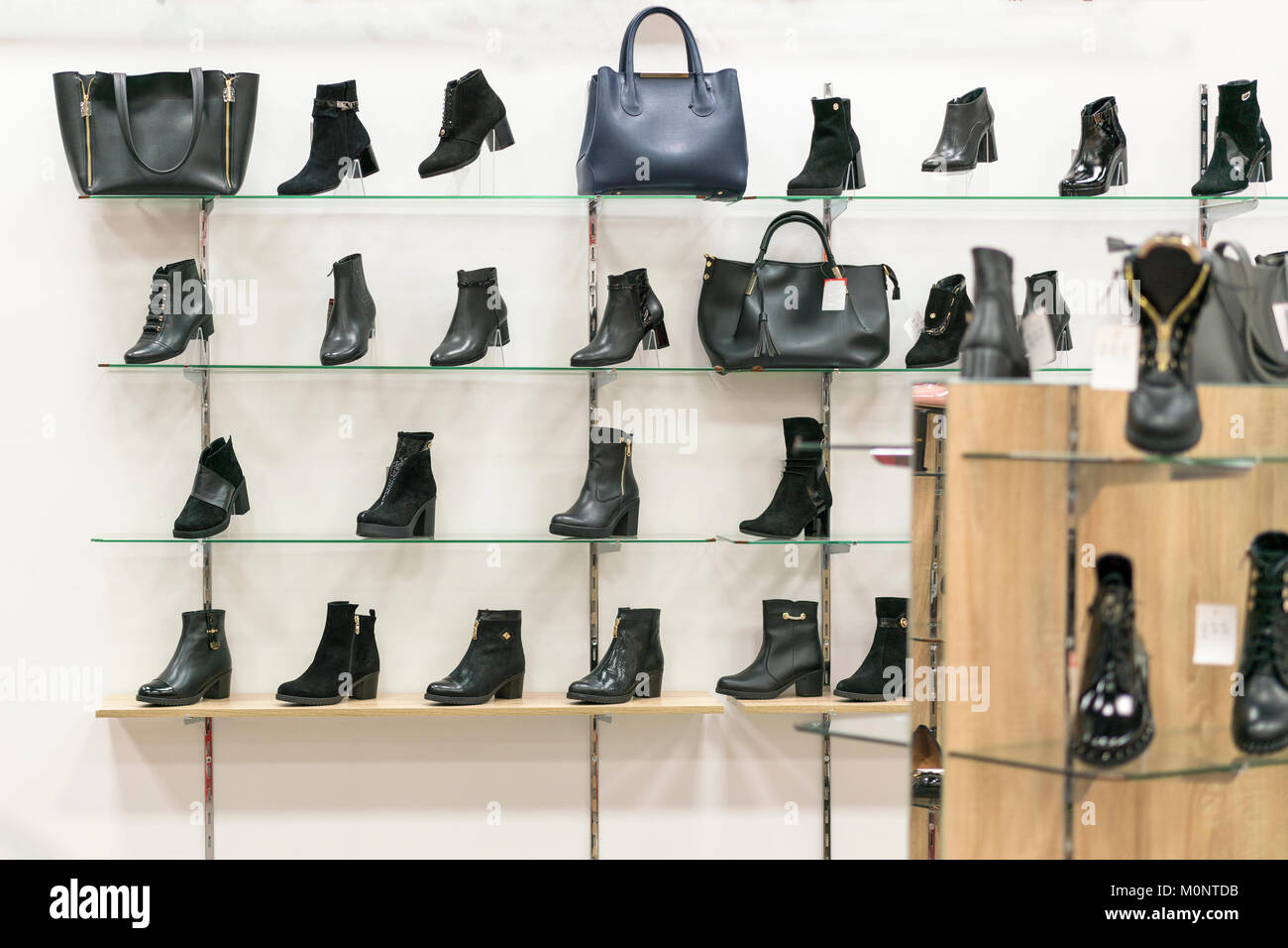 Shelves with leather shoes in a shoe store - Stock Image