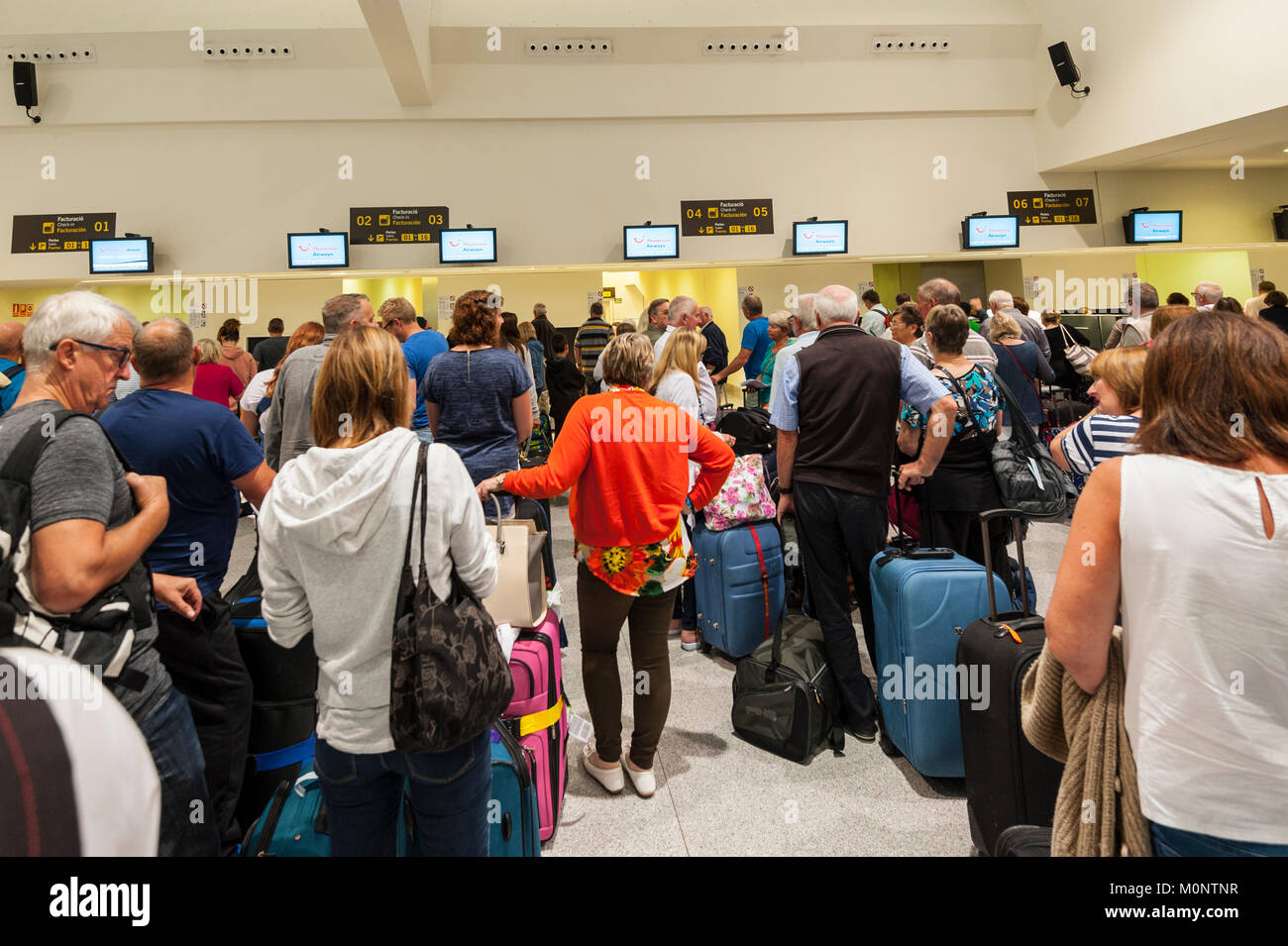 People waiting at the airport in Mahon , Menorca , Balearic Islands , Spain - Stock Image