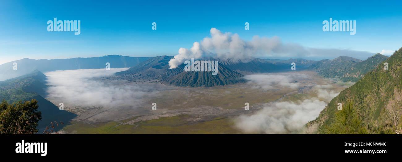 View of volcanoes,smoking volcano Gunung Bromo,Batok,Kursi,Gunung Semeru,Bromo-Tengger-Semeru National Park,Java - Stock Image