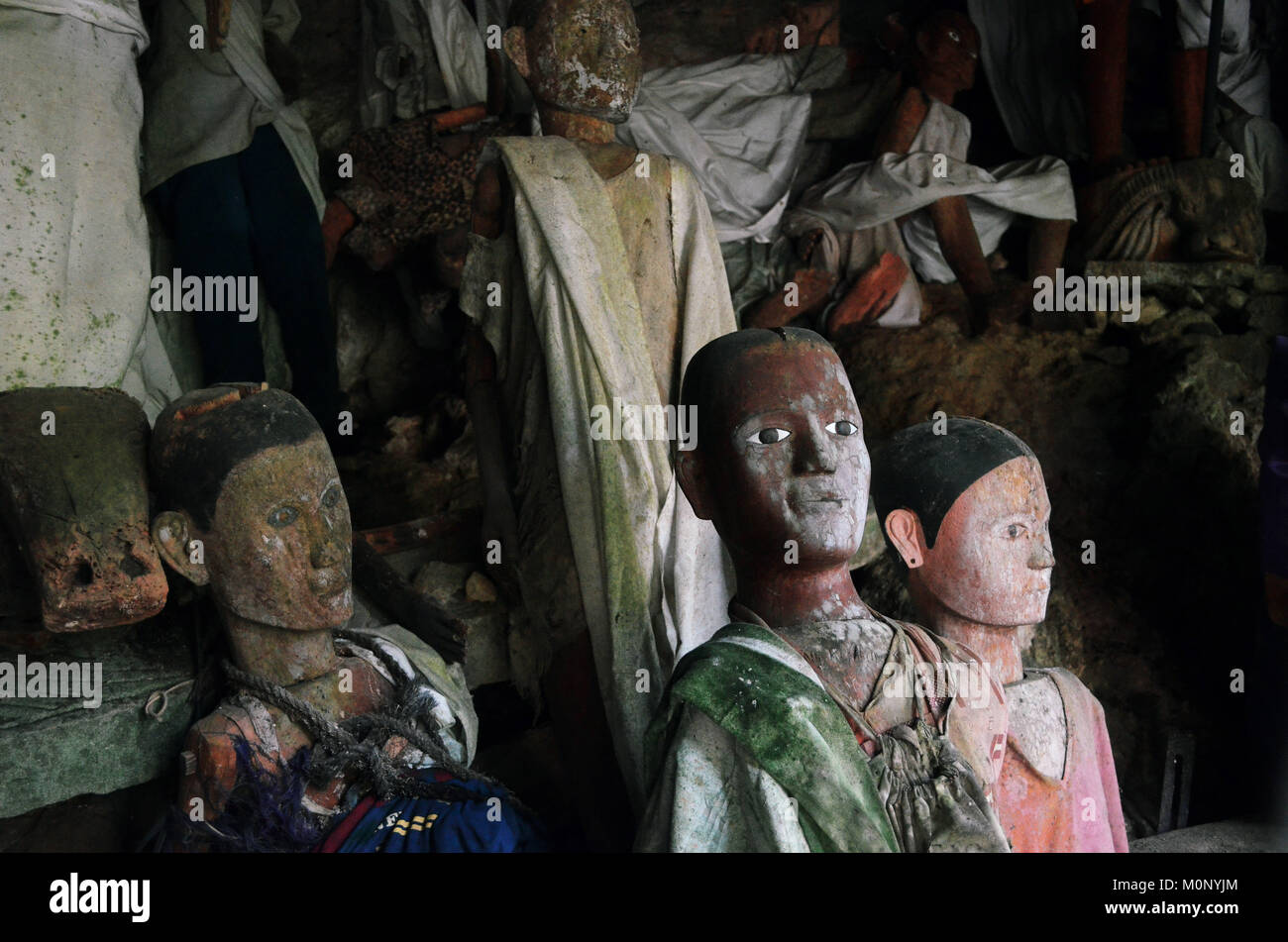 Tau-tau are an effigy Torajan wooden sculpture. - Stock Image