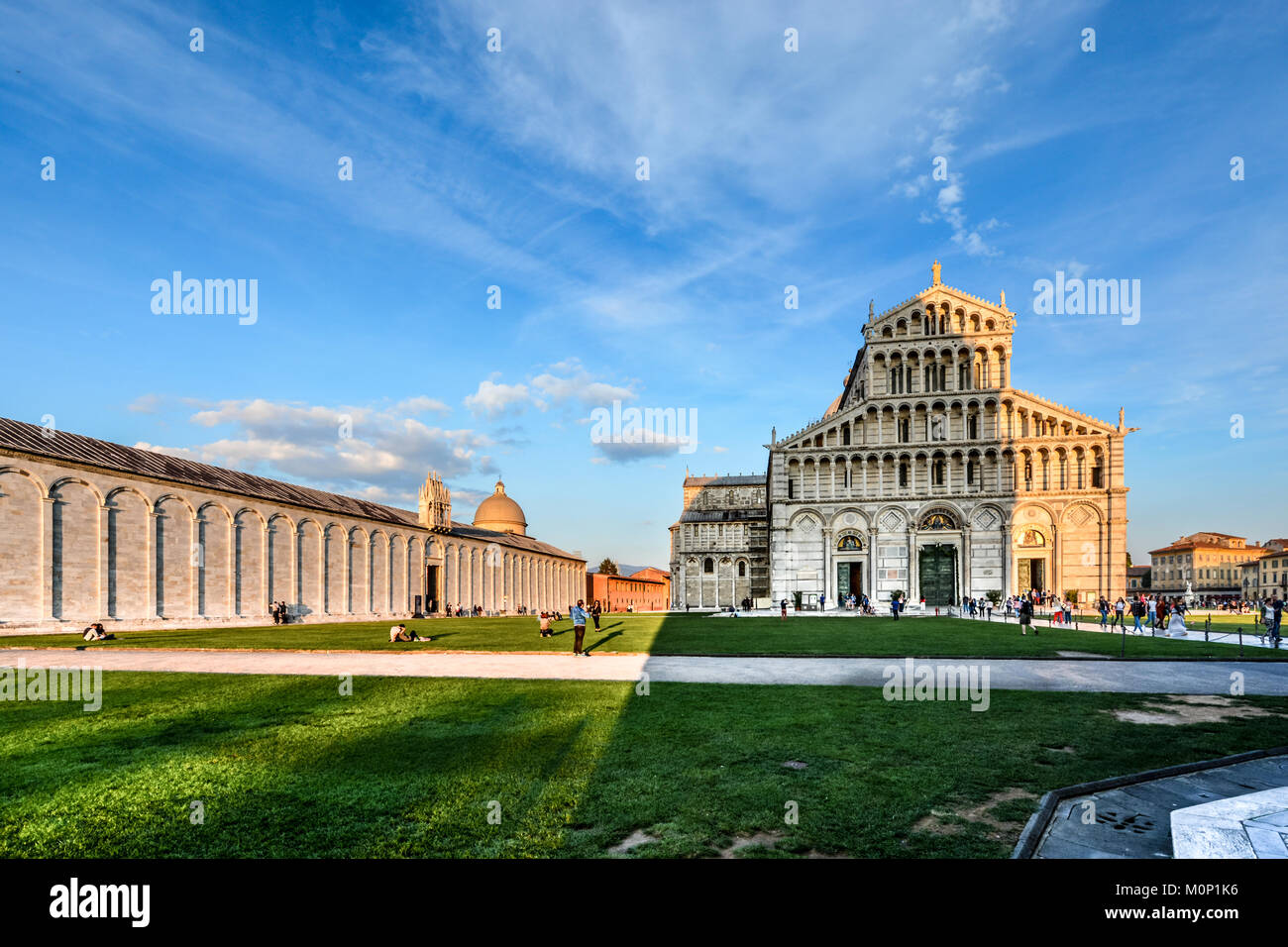 The Camposanto Monumentale and the Duomo, Pisa Cathedral in the Piazza dei Miracoli in Pisa Italy as the Baptistry Stock Photo