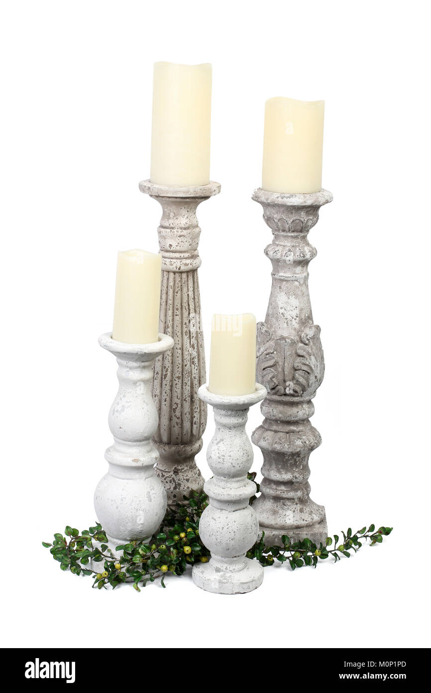 Stone Pillar Candle Holders on Plain Background - Stock Image
