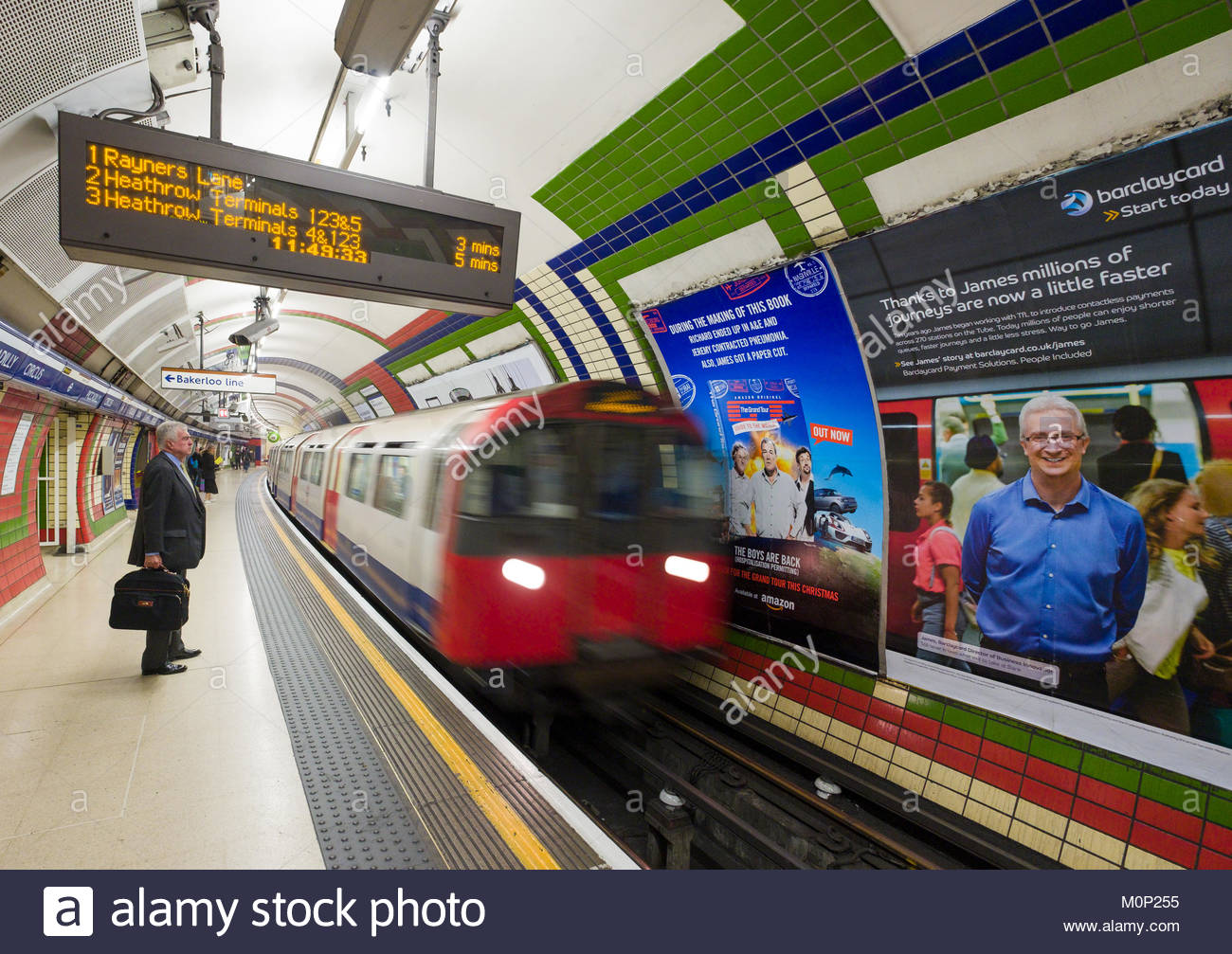 Speeding London Underground train passing Piccadilly Circus Station train platform, City of Westminster, London, - Stock Image