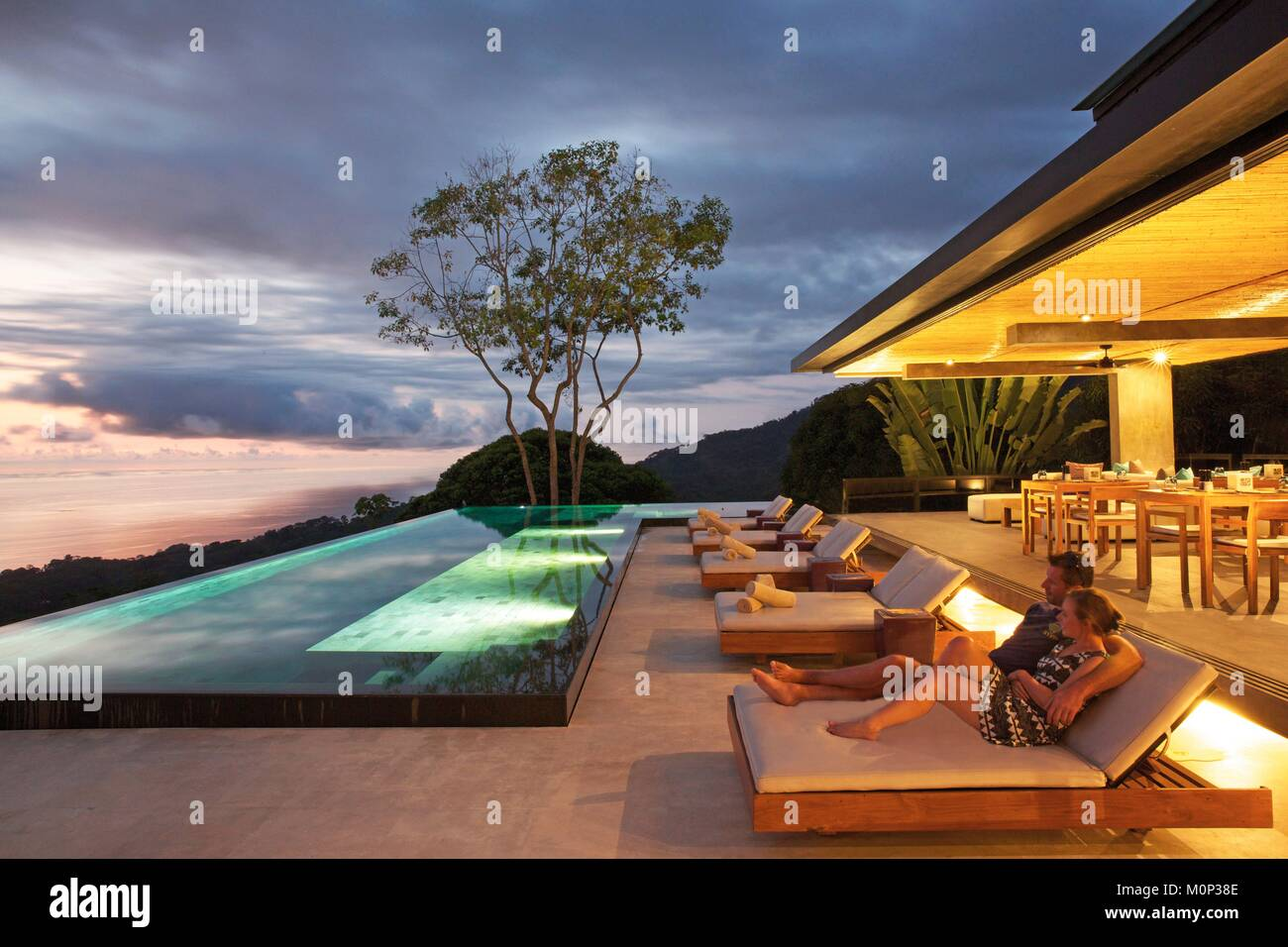 Good Costa Rica,Osa Peninsula,couple In A Transat In Front Of The Pool Of