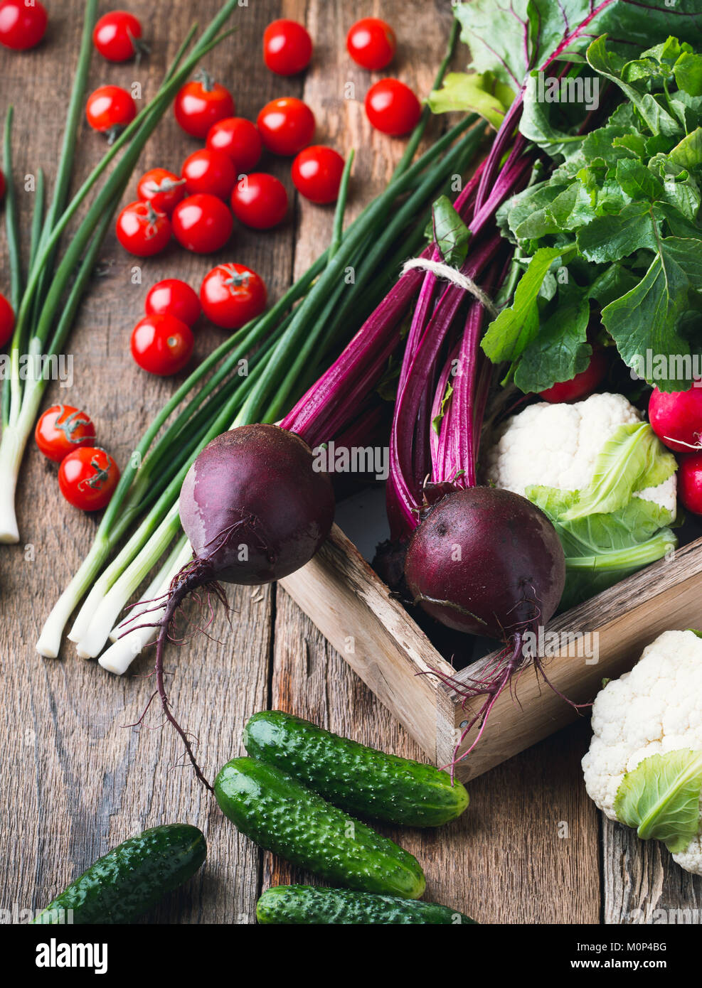 Vegetable farming. Harvest still life.   Food composition of fresh organic beetroots, cucumbers, cauliflower and - Stock Image
